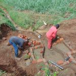 The Water Project: Munenga Community, Francis Were Spring -  Brick Setting