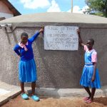 The Water Project: Banja Primary School -  Girls Pose With The Tank