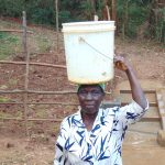 The Water Project: Bumira Community, Madegwa Spring -  Ready To Head Home With Clean Spring Water