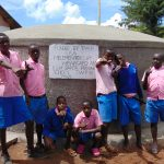 The Water Project: Banja Primary School -  Boys Pose With The Tank