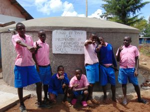 The Water Project:  Boys Pose With The Tank