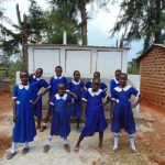 The Water Project: Demesi Primary School -  Girls Pose With Their New Latrines