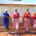 The Water Project: Kakamega Muslim Primary School -  Girls Pose In Front Of Their Latrines