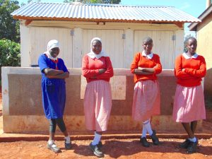 The Water Project:  Girls Pose In Front Of Their Latrines