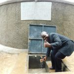 The Water Project: Kapkures Primary School -  School Administrator Celebrates The Tank