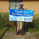The Water Project: Bumira Community, Madegwa Spring -  Proud New Sanitation Platform Owner Says Thank You