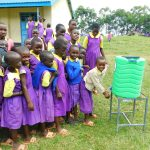The Water Project: Kapkures Primary School -  Girls Line Up To Wash Hands