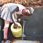 The Water Project: Emulembo Community, Gideon Spring -  Rinsing Container Before Use
