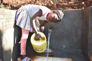 The Water Project:  Rinsing Container Before Use