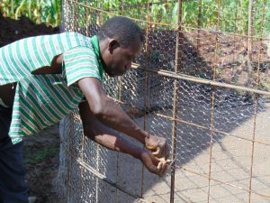 The Water Project:  Adjusting The Wire Wall Forms