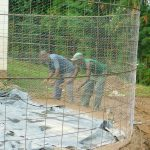 The Water Project: Kapkures Primary School -  Artisans Install Chicken Wire Form