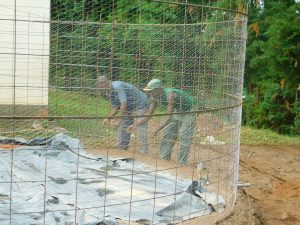 The Water Project:  Artisans Install Chicken Wire Form