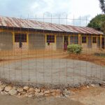 The Water Project: Nanganda Primary School -  Wire And Concrete Set Over Rain Tank Foundation