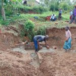 The Water Project: Munenga Community, Francis Were Spring -  Community Helps Deliver Bricks
