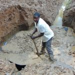The Water Project: Bumira Community, Madegwa Spring -  Setting Concrete For Foundation