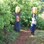 The Water Project: Emulembo Community, Gideon Spring -  Women Walking Home With Water