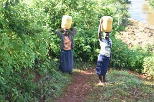 The Water Project:  Women Walking Home With Water