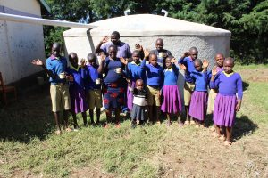The Water Project:  Team Leader Catherine Chepkemoi Stands With Pupils And Staff At The Rain Tank