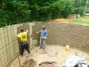 The Water Project:  Cementing Inside The Rain Tank