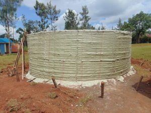 The Water Project:  Rain Tank Walls With Plastic Covering
