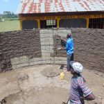 The Water Project: Nanganda Primary School -  Cementing Inside The Rain Tank