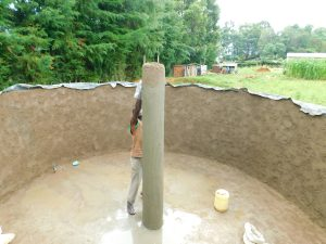 The Water Project:  Plastering The Central Support Column