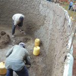 The Water Project: Demesi Primary School -  Cementing Inside The Tank