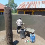 The Water Project: Nanganda Primary School -  Plastering Inside Tank