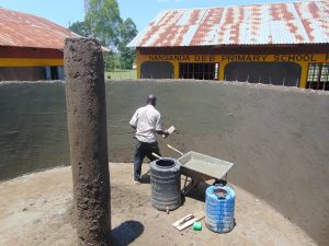 The Water Project:  Plastering Inside Tank