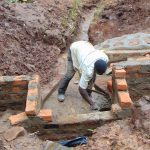 The Water Project: Masuveni Community, Masuveni Spring -  Brickwork Continues