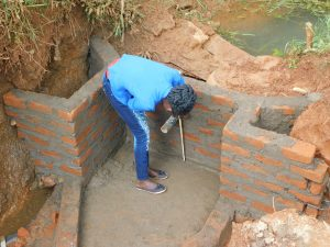 The Water Project:  Field Officer Elvin Confirming Accurate Measurements