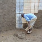 The Water Project: Banja Primary School -  Artisan At Work Inside Tank
