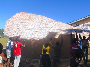 The Water Project:  Students Help Raise The Dome Form Onto The Tank