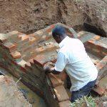 The Water Project: Bumira Community, Madegwa Spring -  Wall Construction