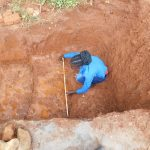 The Water Project: Emulembo Community, Gideon Spring -  Field Officer Elvin Confirming Accurate Measurements Of Spring Stairs