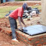 The Water Project: Ebulonga Mixed Secondary School -  Fitting The Manhole Cover To The Access Point
