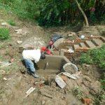 The Water Project: Sambaka Community, Sambaka Spring -  Cementing Interior Of Headwall