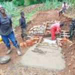 The Water Project: Munenga Community, Francis Were Spring -  Artisan Enjoying His Work