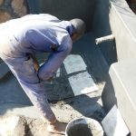The Water Project: Emulembo Community, Gideon Spring -  Tile Setting