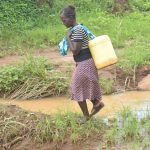 The Water Project: King'ethesyoni Community A -  Carrying Water