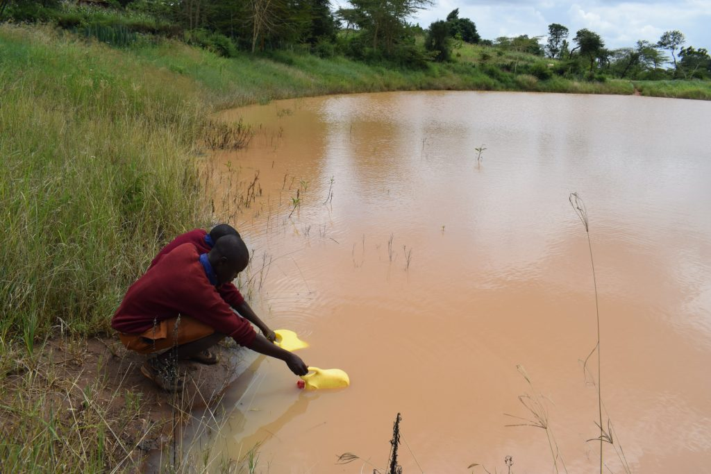 The Water Project : kenya20351-filling-up-container-with-water