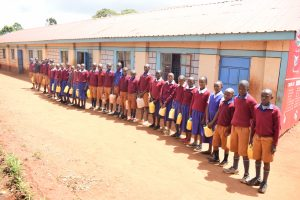 The Water Project:  Students Lined Up With Their Water Containers