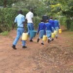 The Water Project: Tyaa Kamuthale Secondary School -  Students Carrying Water