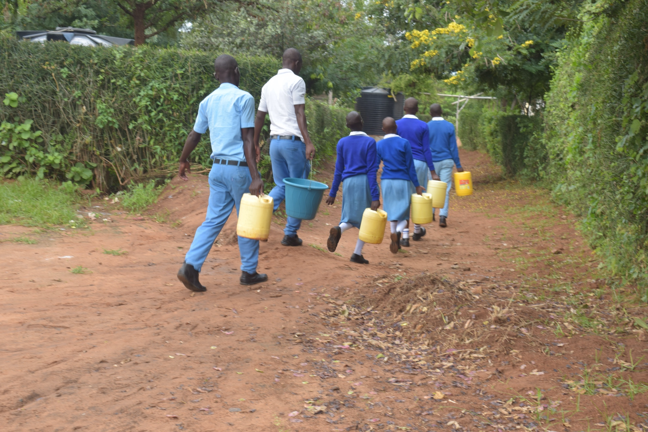 The Water Project : kenya20352-students-carrying-water