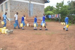 The Water Project:  Students Walk Back To Class Carrying Water