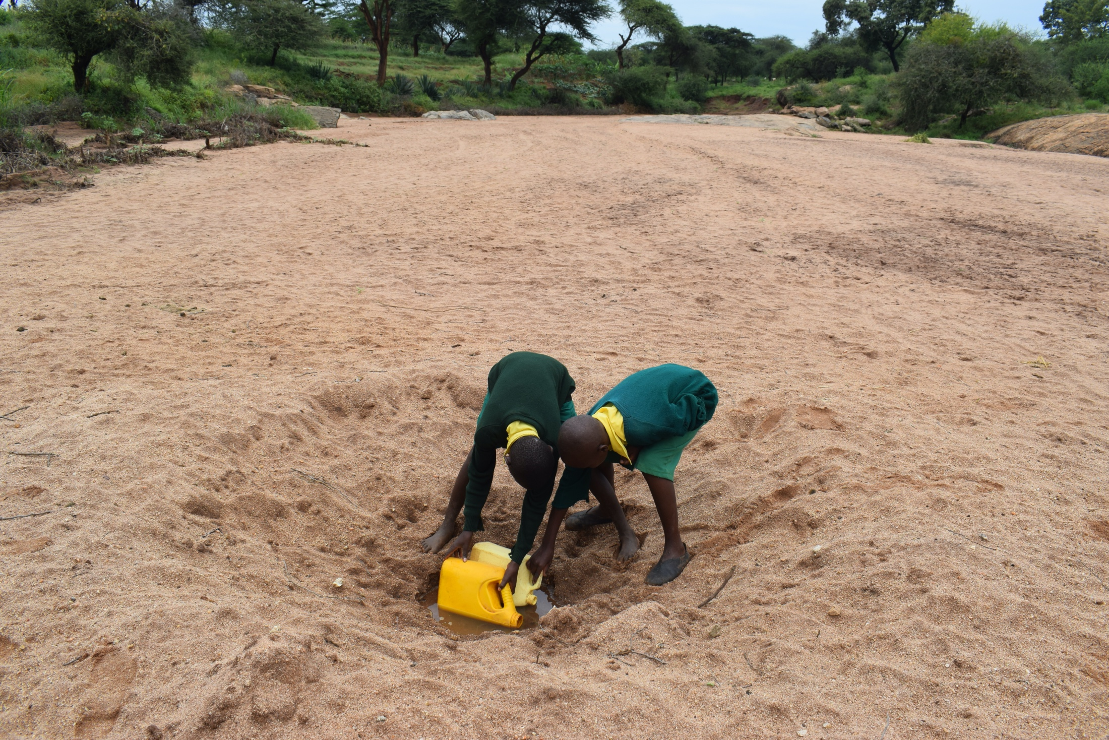 The Water Project : kenya20355-students-at-the-scoop-hole