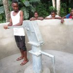 The Water Project: Mathem Community -  Community Member Pumps The Well