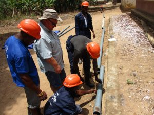 The Water Project:  Laying Pipes