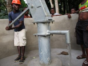 The Water Project:  Pumping The Well After Installation