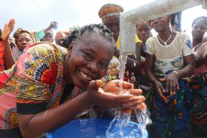 The Water Project:  School Head Teacher Drinks From The Well